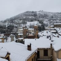Veduta di Modigliana da Vicolo Aldo Celli, con Palazzo Pretorio in lontananza, sotto la neve - Patrizia Diamante - Modigliana (FC)